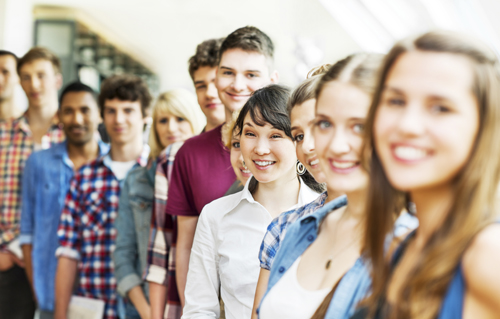 Large group of students standing in a line. Focus on Asian girl.